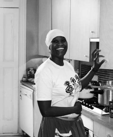 Olorisha Nati in the kitchen helping before an Anya to Oshun. 2009.